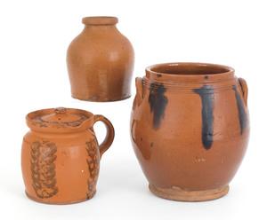 Redware batter jug, jar, and ovoid crock, 19th c.,