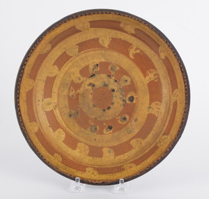 Redware shallow bowl, 19th c., with unusual circle