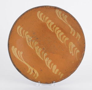 Redware charger, 19th c., with yellow slip decorat