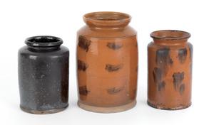 Three redware crocks, 19th c., two with manganesep