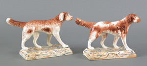 Pair of Staffordshire figures of hounds, early 19t