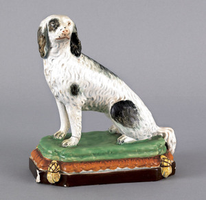 English Staffordshire pearlware figure of seated d