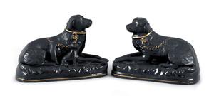 Pair of black basalt glaze pottery dogs, 19th c.,
