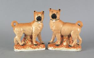 Pair of English Staffordshire pug figures, 19th c.