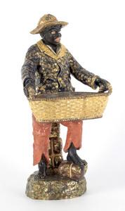 Large Majolica blackamoor figure, 19th c., holding