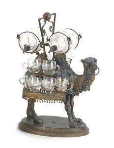 Spelter and enamel glass camel-form cordial set, 1