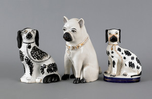 Three Staffordshire dogs, 19th c., to include a pu
