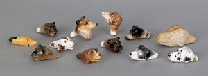Collection of twelve hound-head whistles to includ