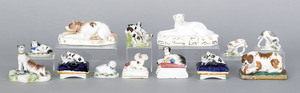 Collection of thirteen porcelain dogs.