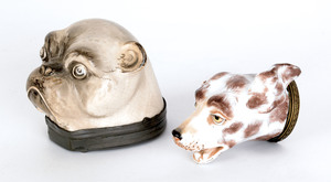 Two hound-head snuff boxes, 19th c., with brass an