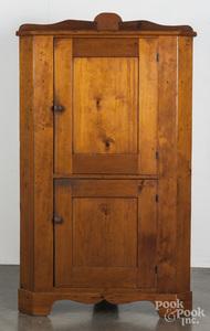 Pine one-piece corner cupboard, 19th c.
