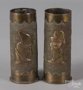 Pr. of trench art shells with Disney dwarf figure