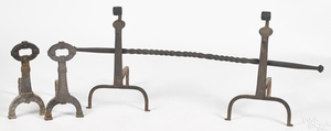 Two pairs of cast and wrought iron andirons