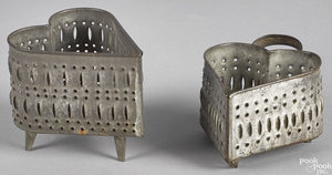 Two punched tin heart form cheese strainers