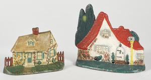 Two cast iron cottage doorstops