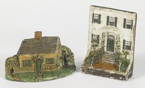 Two cast iron Sarah Symonds doorstops