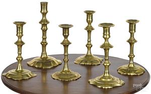 Six English Queen Anne brass candlesticks