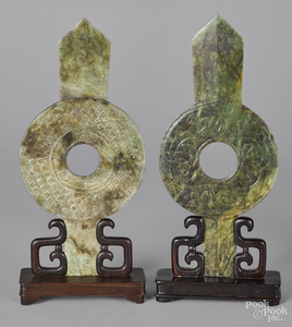 Two Chinese carved spinach jade bi-disc plaques