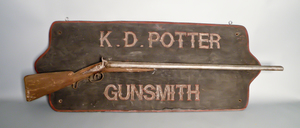 Carved and painted trade sign, inscribed K.D. Pot