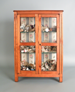 French fruitwood display case, 19th c., housing a