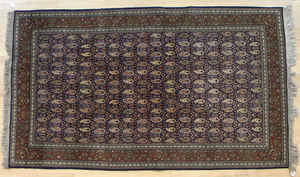 Three oriental carpets, mid 20th c., and later, 8
