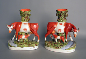 Pair of Staffordshire cow spill vases, 11