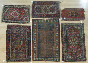 Six oriental mats, largest is 4' 5