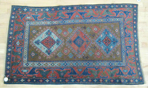Caucasian carpet, early 20th c., with three medal