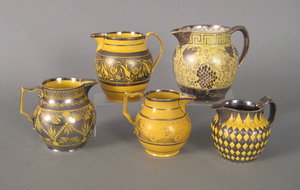 Five canary and silver resist pitchers, early 19t
