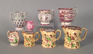 Three graduated pink luster pitchers, 19th c., wi