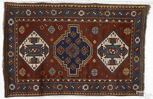 Kazak throw rug, ca. 1910, with 3 medallions on ae