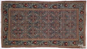 Agra rug, ca. 1900, with overall floral design and