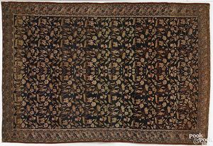 Malayer throw rug, ca. 1910, with overall floral d