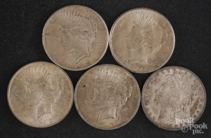 Four Peace silver dollars