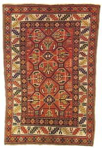 Kazak rug, ca. 1890, with a red field and ivory bo