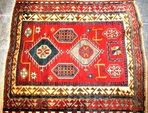 Kazak rug, ca. 1900, with a red field and multiple