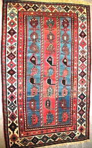 Shirvan rug, ca. 1910, with a blue field and ivory