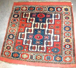 Turkish rug, ca. 1930, with one and a half medalli