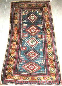 Kazak rug, ca. 1910, with a blue field and gold bo