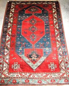 Kazak rug, ca. 1900, with a large diamond medallio