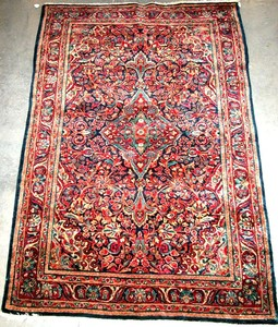 Semi antique Sarouk rug with a central medallion o