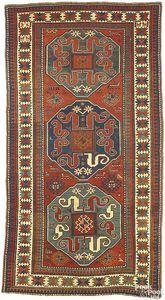 Kazak rug, ca. 1900, with cloud band design and 3e