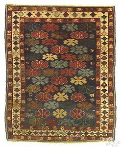 Kuba throw rug, ca. 1900, with stylized leaf motif