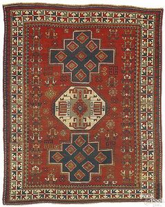 Lori Pambok rug with 3 medallions on a red groundn