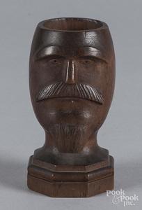 Carved walnut figural match holder