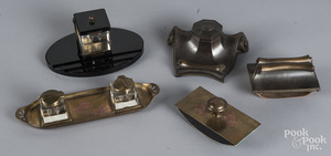 Two Art Nouveau bronze and brass inkwell sets
