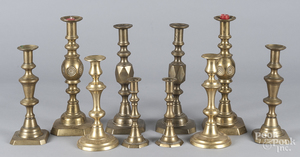 Five pairs of brass candlesticks
