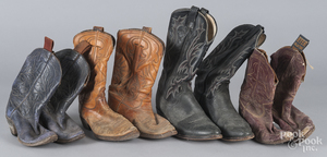 Four pairs of vintage cowboy boots.