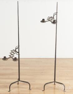 Two adjustable iron floor candleholders