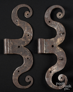 Pair of wrought iron ram's horn hinges